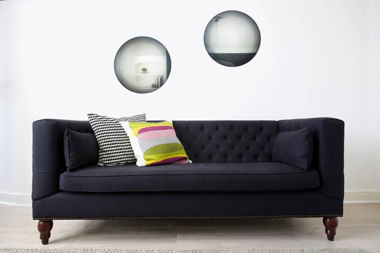 Sofa:  Living room by Cassidy Hughes Interior Design