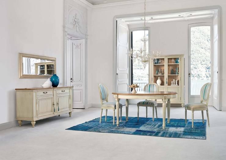 Zona de comedor con mesa ovalada: Comedores de estilo clásico de MUMARQ ARQUITECTURA E INTERIORISMO