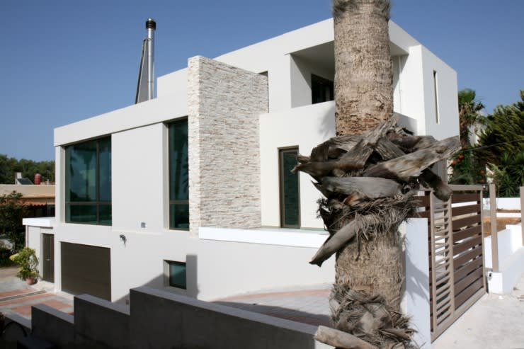Casas de estilo moderno de kuluridis Moderno