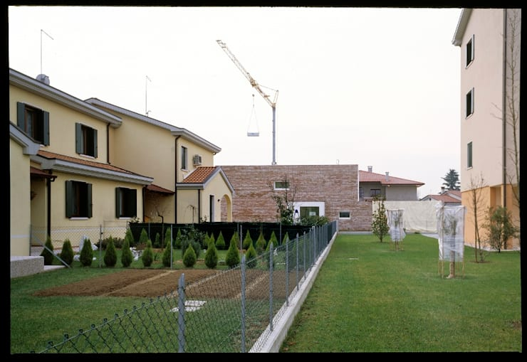 Casa GS: Case in stile  di C&P Architetti - Luca Cuzzolin + Elena Pedrina