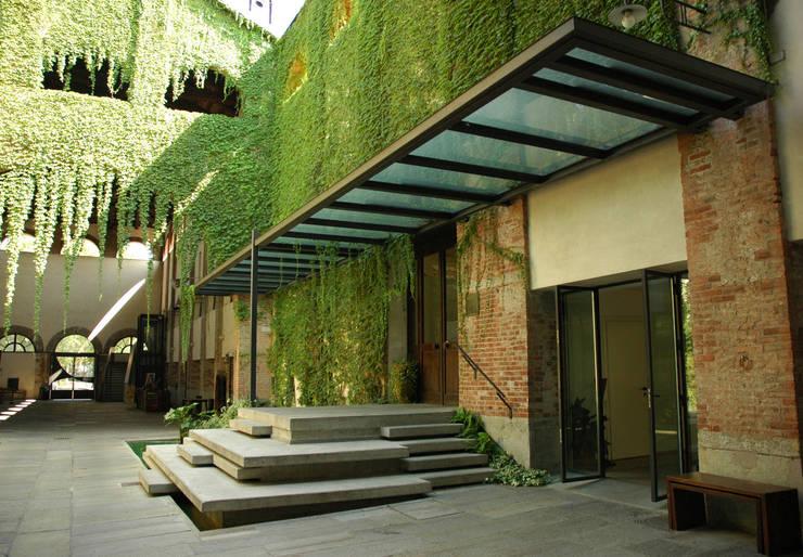 Jardines de estilo  por Comoglio Architetti