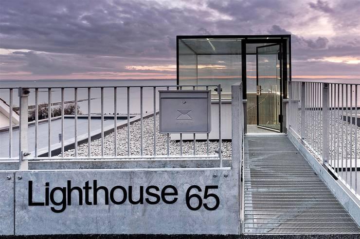 AR Design Studio- Lighthouse 65: modern Houses by AR Design Studio
