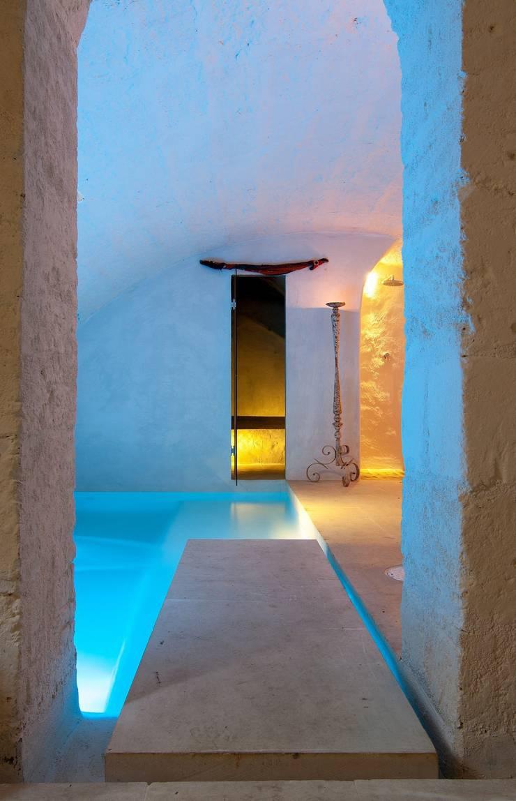 Casa AC: Spa in stile  di Studio Metamor