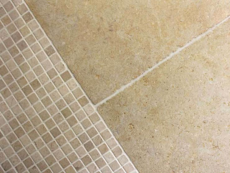 LIMESTONE FLOOR TILES:  Walls & flooring by DT Stone Ltd