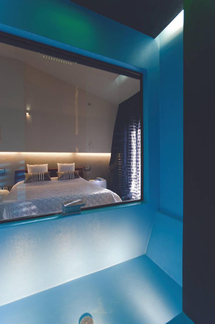 Habitaciones de estilo  por Enrico Muscioni Architect