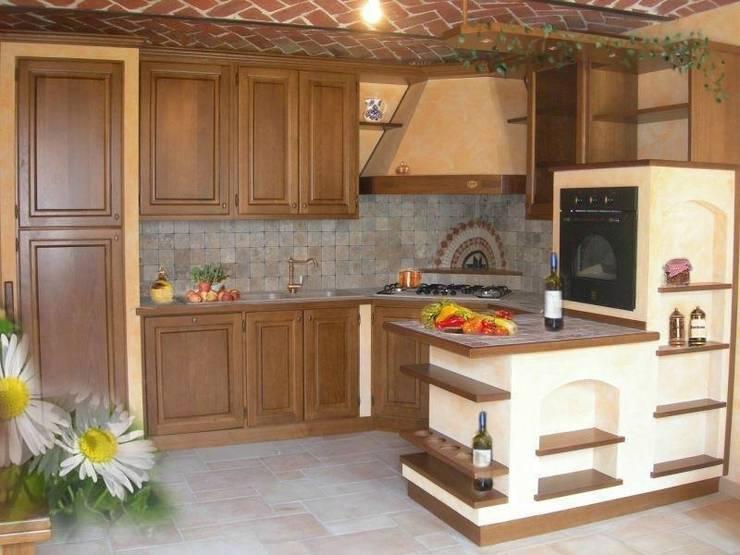 CUCINA in finta muratura : Cucina in stile in stile Rustico di CORDEL s.r.l.