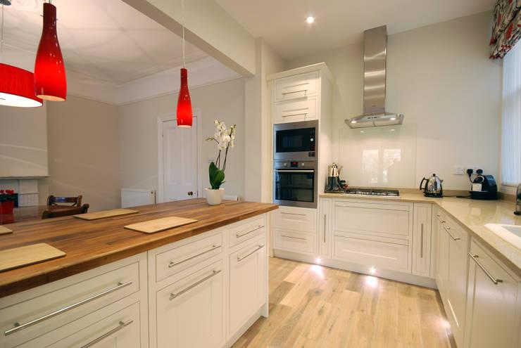 Creation of an open plan kitchen:  Kitchen by Emmanuelle Lemoine Interiors