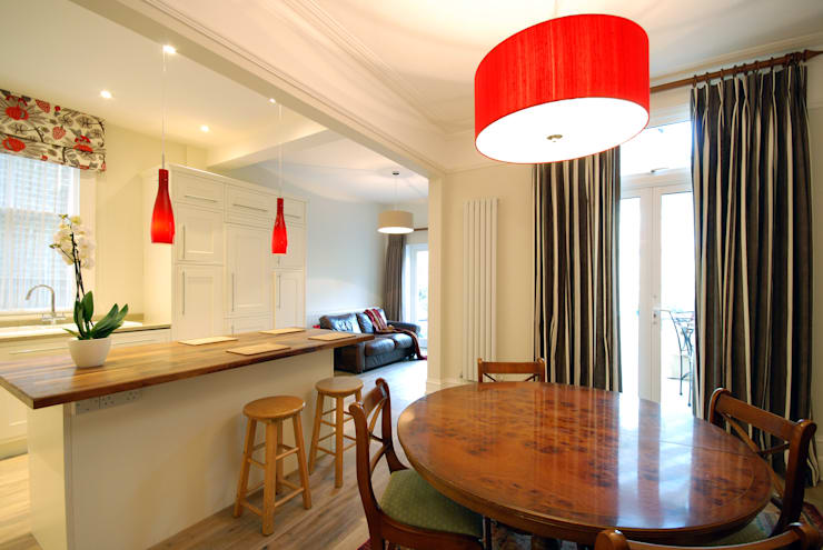 Creatio of open plan kitchen:  Dining room by Emmanuelle Lemoine Interiors