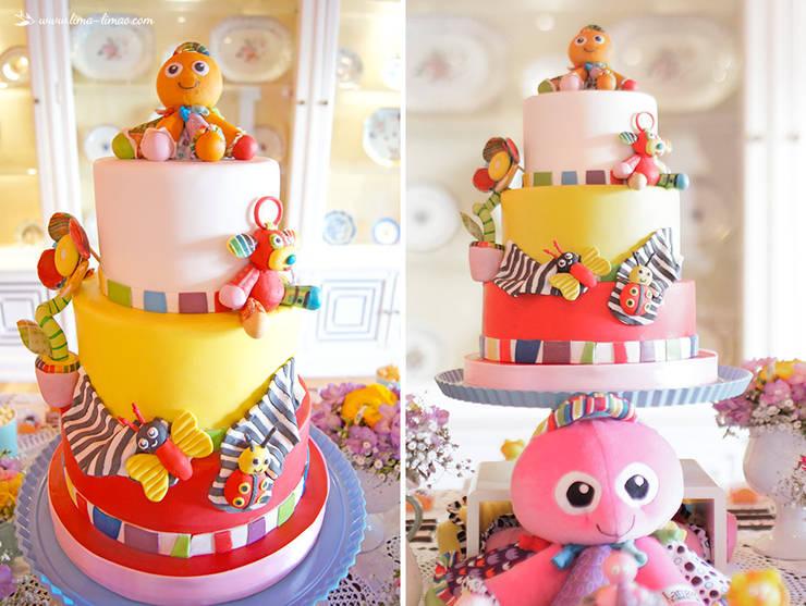 O delicioso e espectacular bolo de aniversário, repleto de todos os brinquedos preferidos da Maria Francisca.: Sala de jantar  por Lima Limão-  Festas com charme