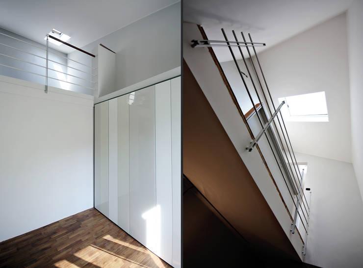 Private Flat APP_G_AL: Ingresso & Corridoio in stile  di Diego Bortolato Architetto
