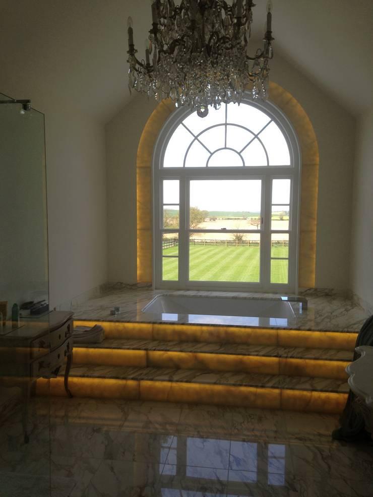 Warm white LED panels behind onyx.: classic Bathroom by Translucent Creations Ltd