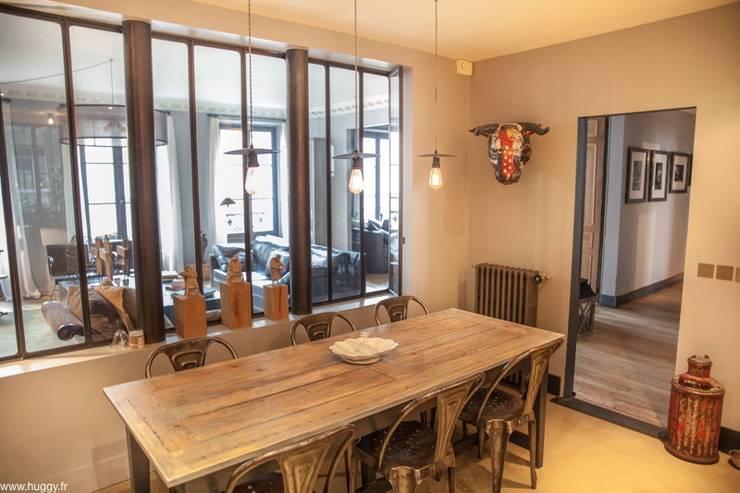 Apperçus de travaux de rénovation: Salle à manger de style de style Classique par HUGGY