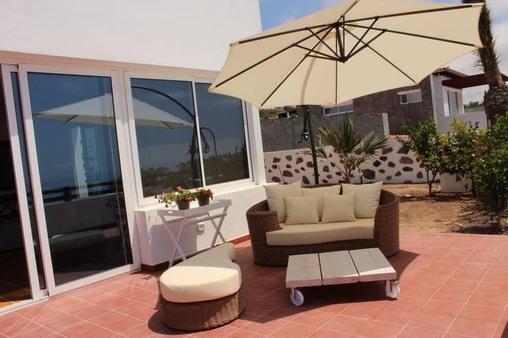 Terrazas  de estilo  por Tatiana Doria,   Diseño de interiores