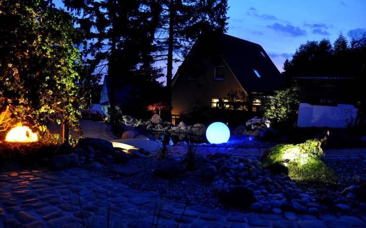 Emotionale Gartenbeleuchtung: ausgefallener Garten von Oswald Gärten