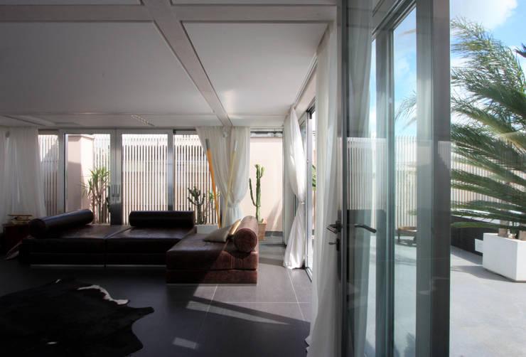 Salas de estilo  por Piano B Architetti Associati