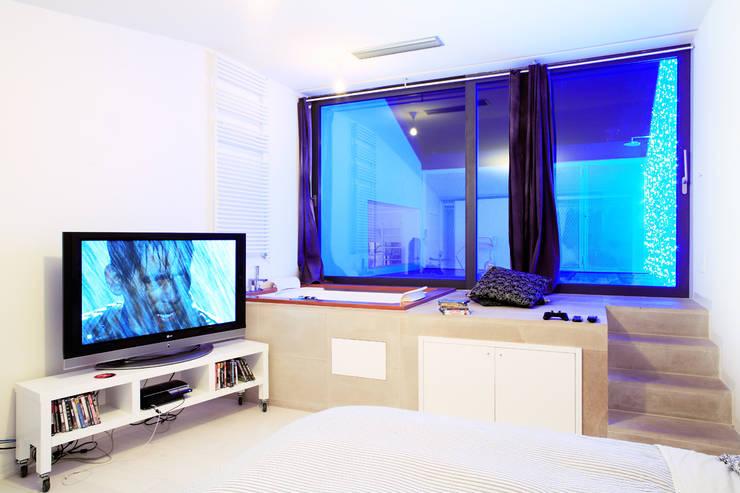 Dormitorios de estilo industrial de roberto murgia architetto