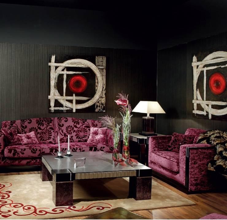 Sofá de tres y dos plazas.: Salones de estilo  de MUMARQ ARQUITECTURA E INTERIORISMO