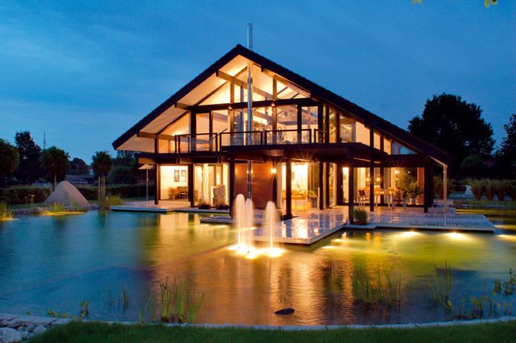 Modernes Holzhaus in Hannover:  Häuser von DAVINCI HAUS GmbH & Co. KG