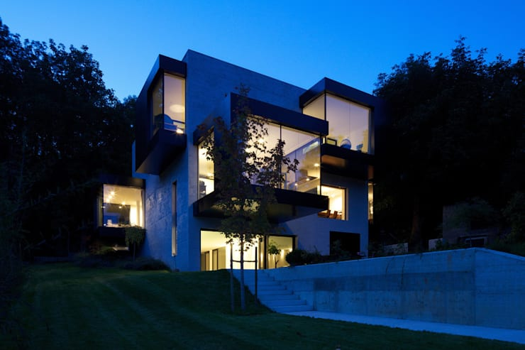 tra le foglie, casa p: Case in stile  di bergmeisterwolf architekten