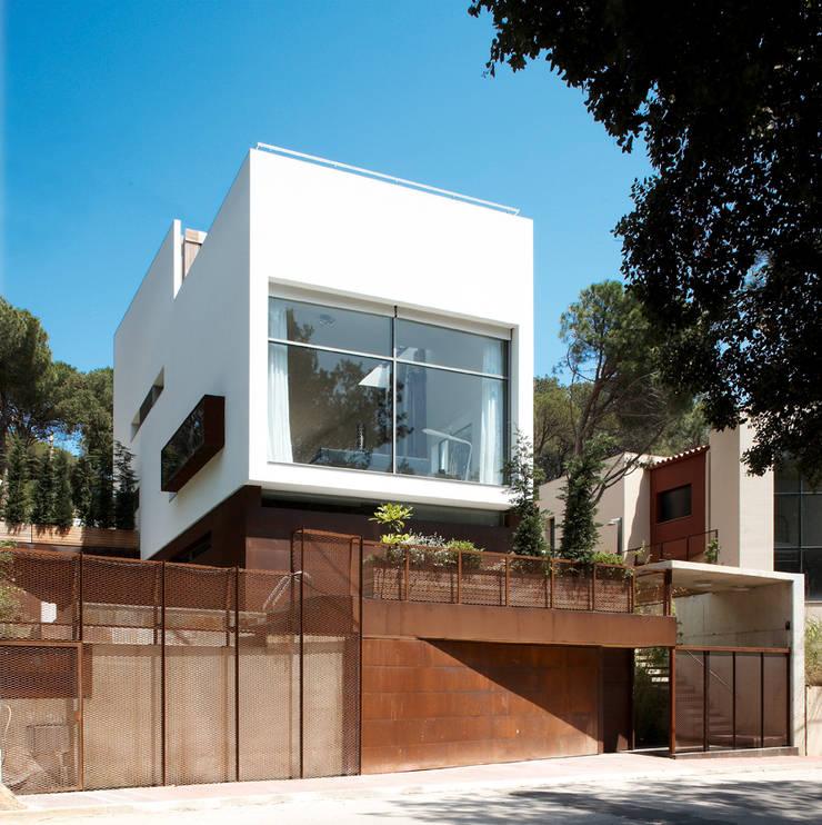 Casas de estilo  por Octavio Mestre Arquitectos,