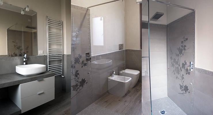 RISTRUTTURAZIONE DI UN APPARTAMENTO CON CUCINA A VISTA: Bagno in stile  di Laura Lucente Architetto