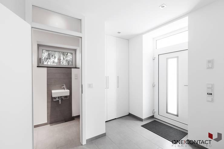 Corridor & hallway by ONE!CONTACT - Planungsbüro GmbH