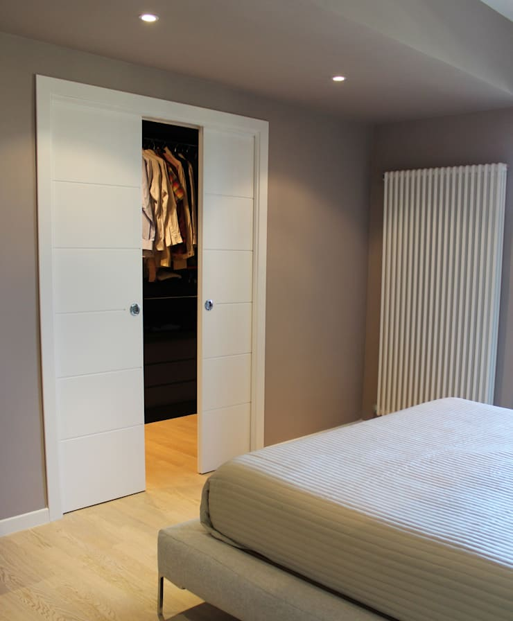 MGD Home: Camera da letto in stile  di Ernesto Fusco
