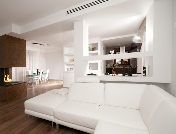 Ristrutturazione di una villa bifamiliare su tre livelli in Roma - 240 mq: Soggiorno in stile  di Fabiola Ferrarello architetto