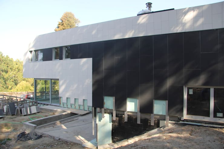 Vivienda Unifamiliar en Vigo (Spain): Casas de estilo  de HUGA ARQUITECTOS