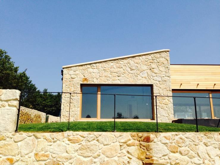บ้านและที่อยู่อาศัย by HUGA ARQUITECTOS