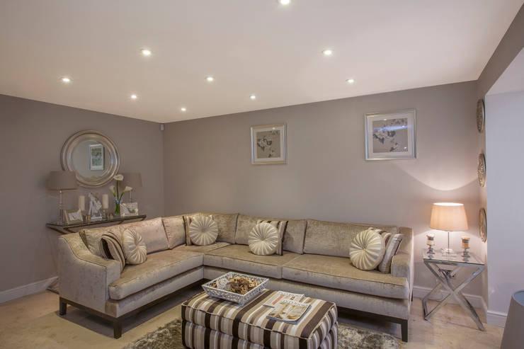Living room—Canary Wharf:  Living room by Millennium Interior Designers