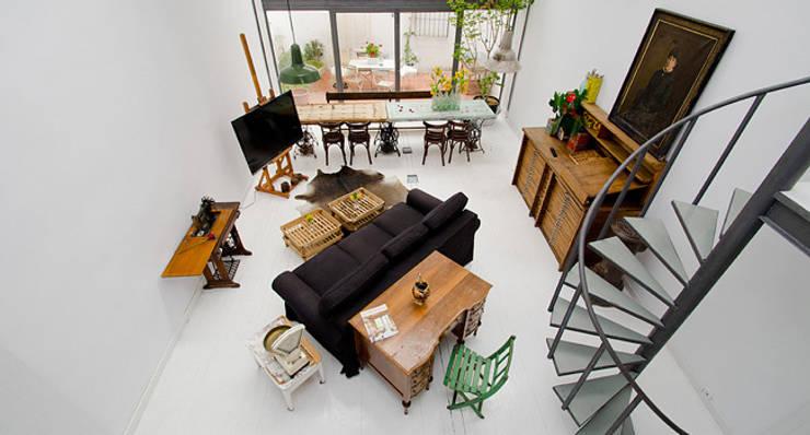relax en atocha: Salones de estilo ecléctico de Make sense studio