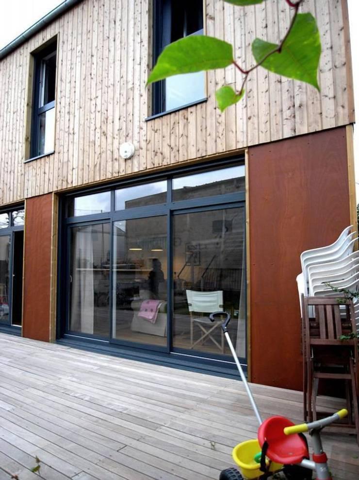 Maison AND: Maisons de style  par Allegre + Bonandrini architectes DPLG
