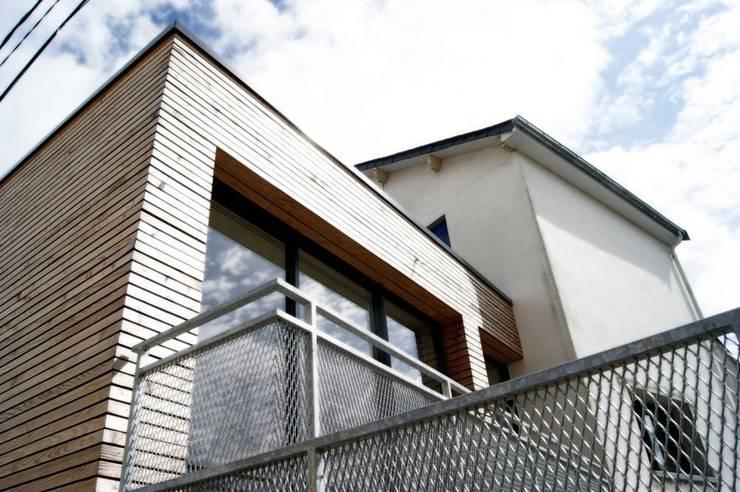 Extension BR: Maisons de style  par Allegre + Bonandrini architectes DPLG
