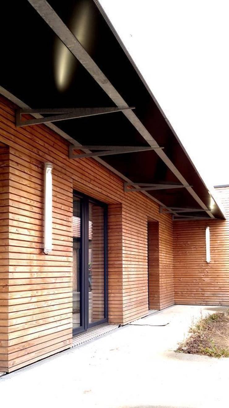 10 logements sociaux Passifs: Maisons de style  par Allegre + Bonandrini architectes DPLG