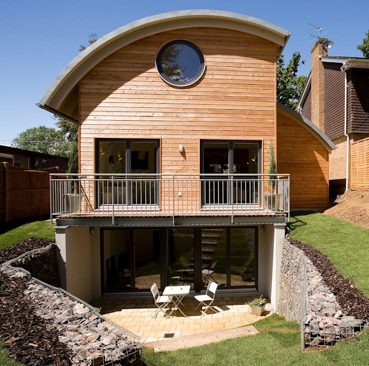 Timber Clad Passive House with Curved Roof:  Houses by haus ltd