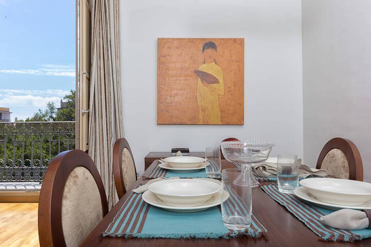 Dining room by Espacios y Luz Fotografía,