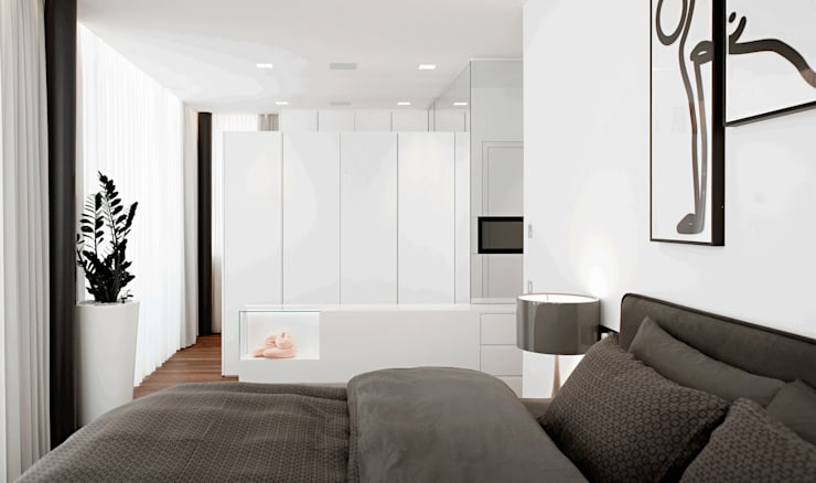 Casa M: Camera da letto in stile  di monovolume architecture + design