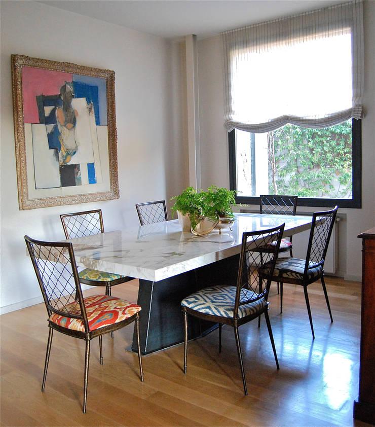 Diseño de comedor: Comedor de estilo  de Ines Benavides