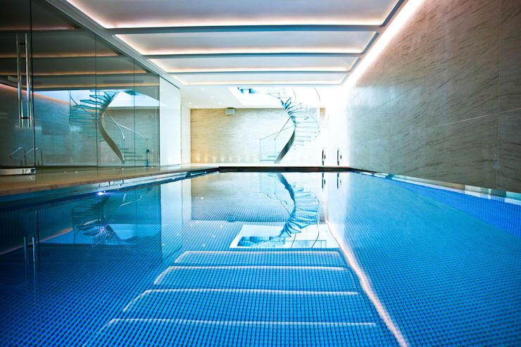 Pool & Wellness Area with Spiral Staircase: modern Pool by London Swimming Pool Company