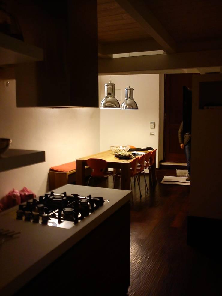 Dining room by Studio DeGli Architetti  G. De Angelis - F. Glionna, Modern