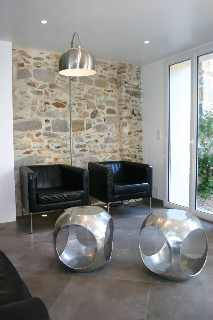 Salon: Salon de style de style Moderne par mia casa