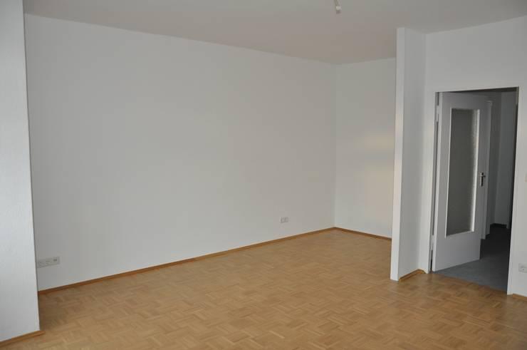 Leerer Wohn-und Essbereich:  Wohnzimmer von Optimmo Home Staging,Modern
