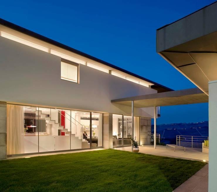 Casa Visiera: Case in stile  di ARCHICURA, Moderno