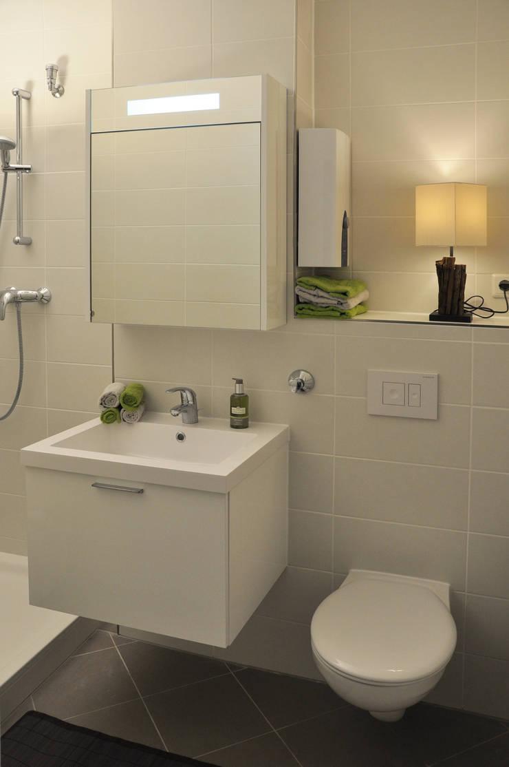 Badezimmer nach dem Home Staging:  Wohnzimmer von Optimmo Home Staging,Modern