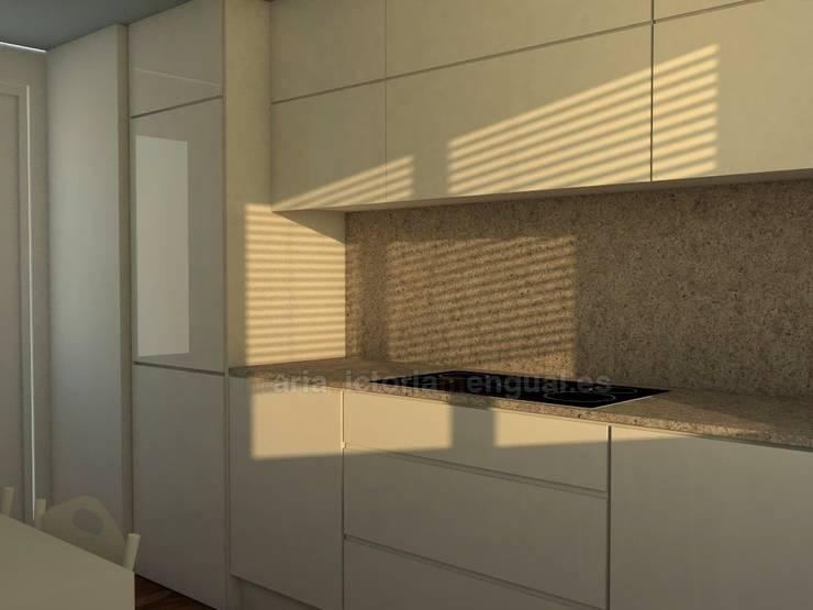 Zona de cocción y frigorífico panelado.: Cocinas de estilo  de MUMARQ ARQUITECTURA E INTERIORISMO