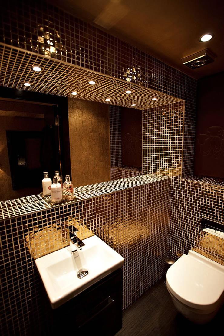 Sumptuous duplex apartment:  Bathroom by Asco Lights