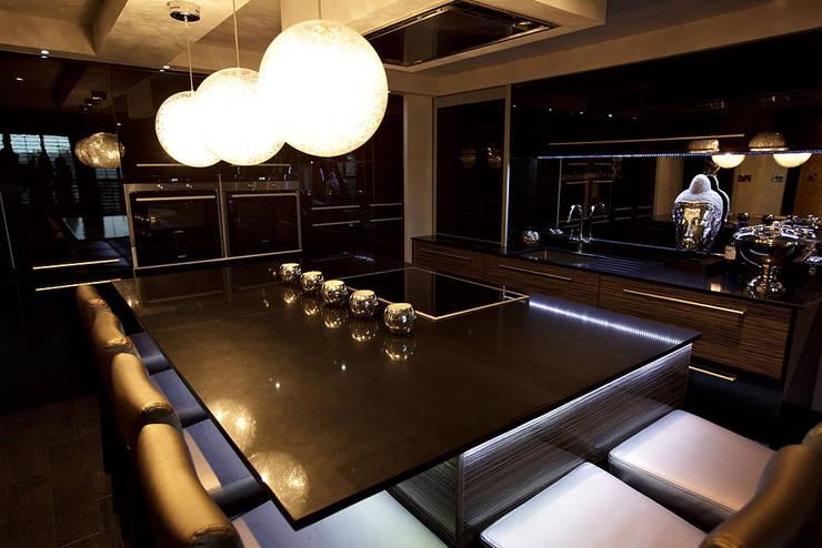 Sumptuous duplex apartment:  Kitchen by Asco Lights