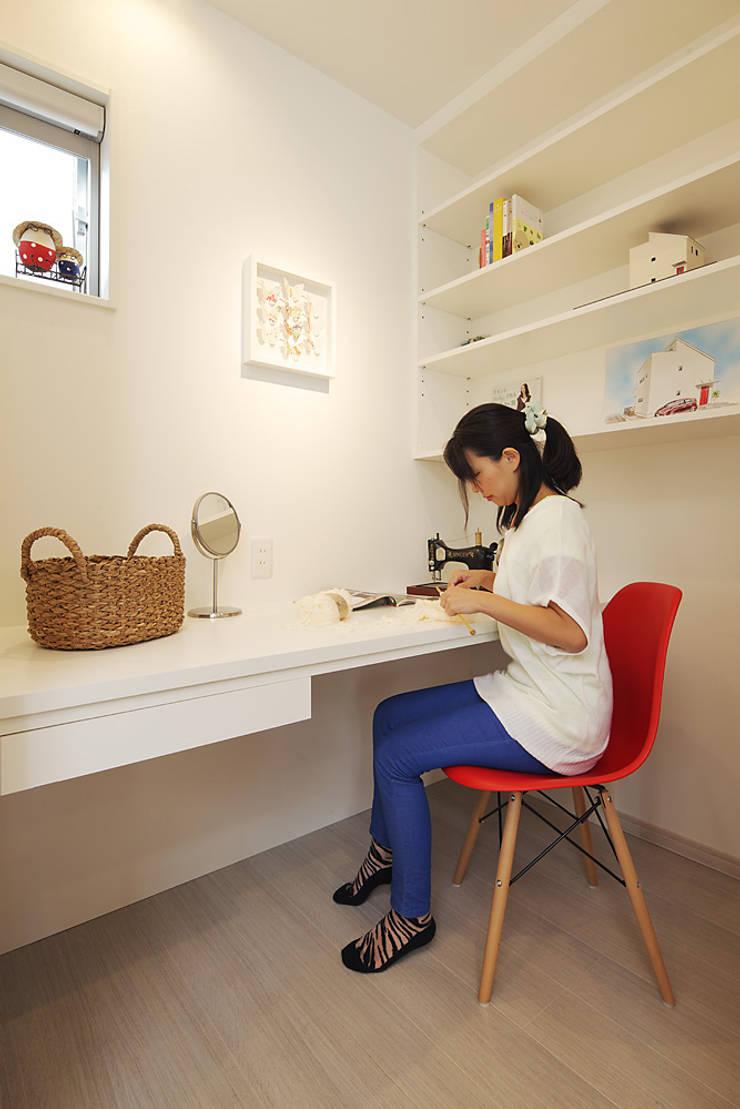 もっとのいえ: 有限会社タクト設計事務所が手掛けた多目的室です。