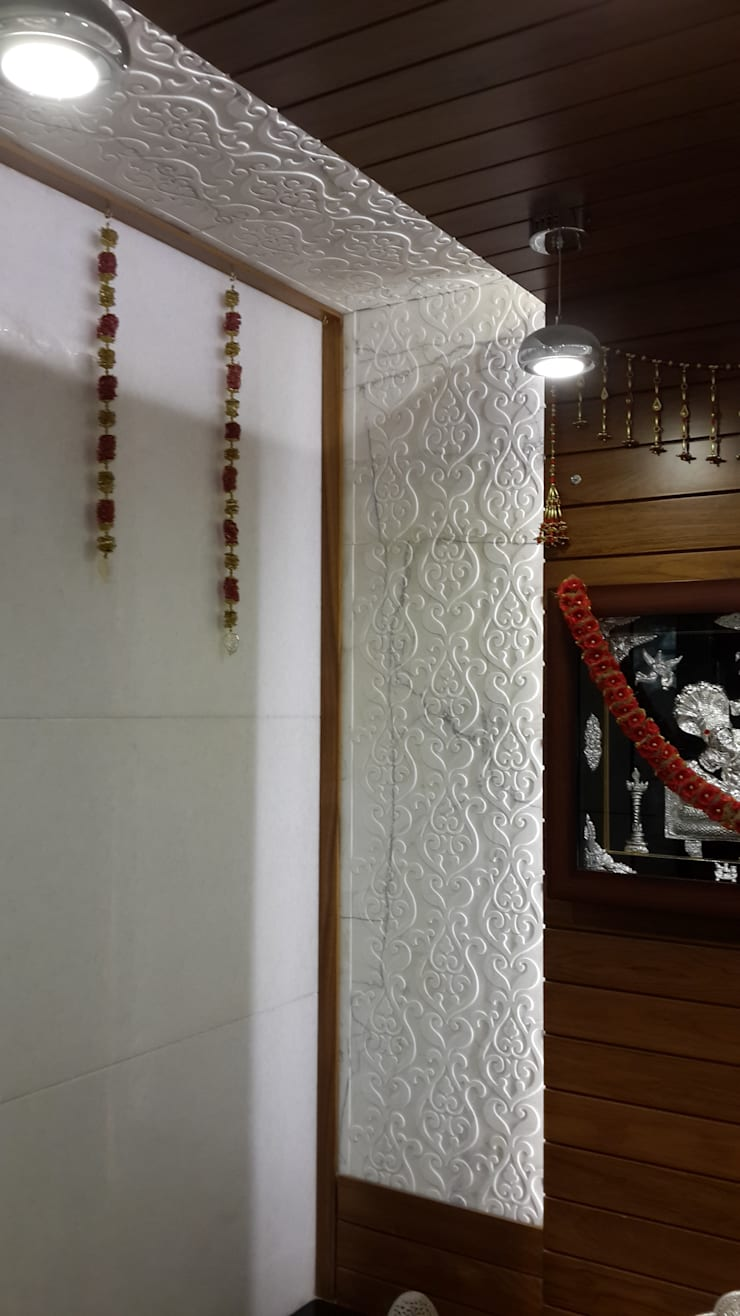 Pooja room wall with Carved Marble cladding:  Corridor & hallway by Hasta architects